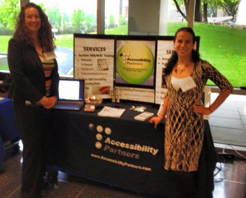 Sharon and Dana exhibiting at a conference