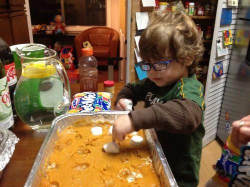 Image of Dana's son making the sweet potatoes.