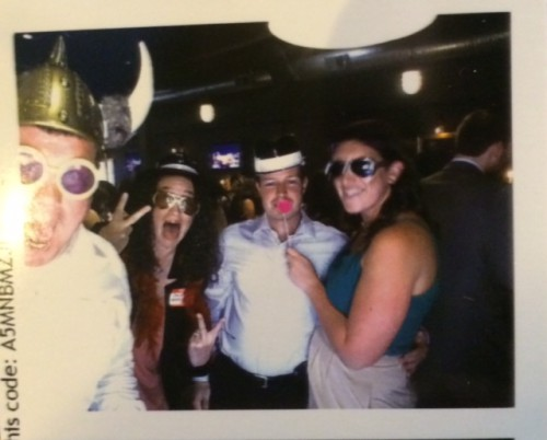 Dana with Meredith and other celebrants at a photo booth