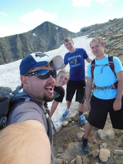 Ryan in Colorado with his family atop a snowy mountain