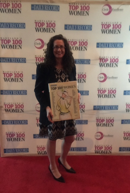 Dana holding her Top 100 Women Award