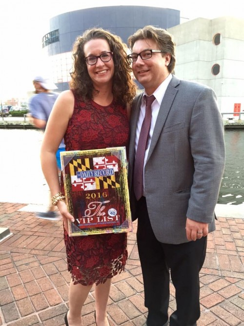 Dana and Preston Blay with Dana's award in the Inner Harbor of Baltimore