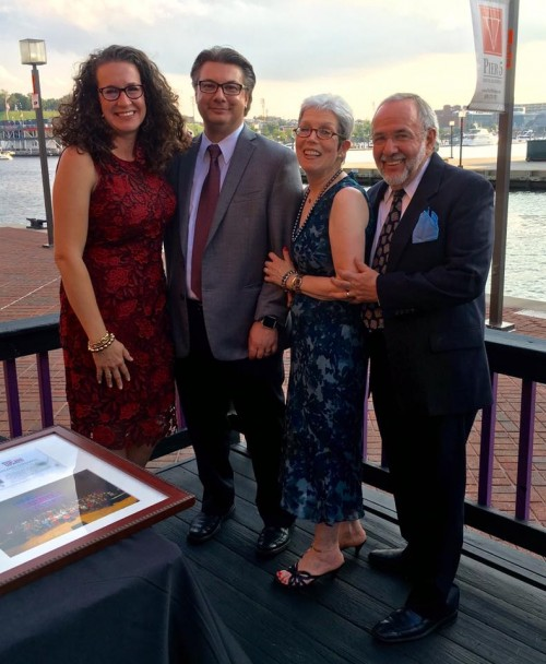 Dana with her husband, mother, and step father by the Baltimore Harbor